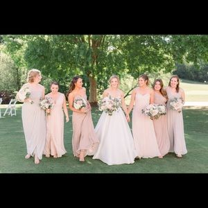 Strapless chiffon bridesmaid dress in pale pink.